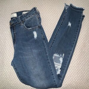 Distressed Mid Rise Jeggings